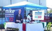 Local supporters for US democratic presidential hopeful, billionaire businessman Mike Bloomberg at their campaign booth.