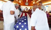 Pallbearers escorted into the Futiga Catholic Church last Thursday during the family service, the U.S. flag-draped coffin of  Ulufaleilupe Fuimaono Ta'aala Leulua'ialii Filifaiesea Fa'asuamalie