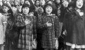 children at the Weill public school in San Francisco recite the Pledge of Allegiance. Some of them are evacuees of Japanese ancestry who will be housed in War Relocation Authority centers for the duration of World War II.