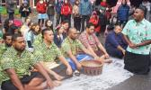 Pacific island climate change campaigners hold a traditional Fijian sevusevu and offer tapa to a community impacted by a massive coal mine in Germany. [Photo: Facebook]
