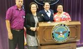 Cong. Aumua Amata congratulates newly promoted Major Mercy Te'o with her parents Su'a Philo and Mrs. Jennings.