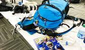 The Pacsafe Venture X40 is a class act on the trail, as carry-on in an overhead airline bin, or in the inner sanctum of the historic Rose Bowl Photo Media room, as pictured.  [Photo: Barry Markowitz, 9/9/17]