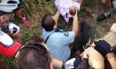 The dramatic moment the baby was rescued after five days down a 2.4m drain where he was left by his mother in November 2014. [photo / supplied]
