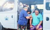 Nurse giving man a vaccination in the Public Health van