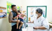 Nurse Fa'atafa Tavita (R) speaking with a father holding his child at the Apia Town Clinic in Samoa's capital city Apia.
