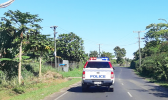 A Samoa police vehicle patrolling the highway