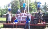 Fa'asao Marist High School sign with students in front