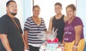 Family of New Years baby with gift packages