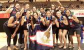 The American Samoa women's basketball team celebrate atop the podium with their gold medals.