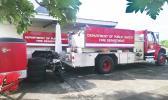 Two firetrucks awaiting parts