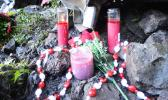 Flowers and candles were placed at the scene where two firefighters were killed