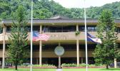 American and American Samoa flags at half staff outside EOB