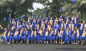 Fa'asao Marist High School 2020 graduates throwing caps in the air