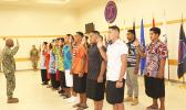 7 American Samoa young men and women during the swearing in ceremon