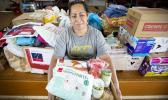 Fatima Sae with some of the donations