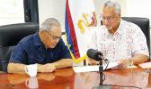 OIA Director Nikolao Pula with Governor Lolo Moliga