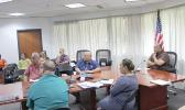 Governor with directors during virtual meeting with DOI