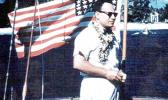 Gov. Tali Peter T. Coleman with a 48-star U.S. flag