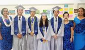 The Class of 2017 of Manumalo Academy High School with principal Tiana Trepanier (far left) and faculty members Seongshim Park and Miriam Mirasol (far right). The four graduates were all recipients of the congressional award and all of them will be continuing their education at off island colleges and universities. This is the first high school graduating class for the Flames since 2013. [photo: Blue Chen-Fruean]