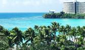 Photo of large hotel building in the distance in Guam