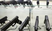 This June 29, 2016, file photo shows guns on display at a gun store in Miami. Support for tougher gun control laws is soaring in the United States, according to a new poll that found a majority of gun owners and half of Republicans favor new laws to address gun violence in the weeks after a Florida school shooting left 17 dead and sparked nationwide protests. (AP Photo/Alan Diaz, File)