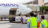 Hawaiian Air employees unload HAL plane bringing masks to Hawaii.