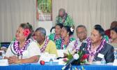 Samoa's National Health Services General Manager Tupuimatagi Palanitina Toelupe (left) and Pastor Leonard Solomona, Founder of First-Touch Ministry Boot Camp of Samoa, along with members of the Samoa delegation (in the background) at yesterday's opening of the three-day 7th Bilateral Health Summit of the two Samoas hosted by American Samoa at the Gov. H. Rex Lee Auditorium.  [photo: AF]