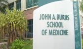 Sign at entrance to John Burns School of Medicine at UH