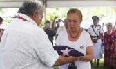 uilaepa Dr. Sa'ilele Malielegaoi presents the flag of Samoa to Celine Keil