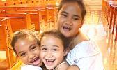 3 laughing and joyful young girls