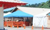 The LBJ COVID-19 triage tents set up in front of the hospital