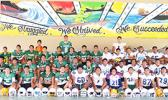 "Leone High School, ""Home of the Lions"" – Football Team, both Varsity and Junior Varsity (JV) combined in this team photo. Led by Head Coach Okland Salave'a, they will open this year's football season against the Vikings this Saturday morning at the Veterans Memorial Stadium. [photo: TG]"