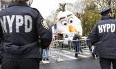 Police standing watch a day before the Thanksgiving Day parade