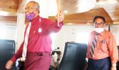 ASG Treasurer Malemo L. Tausaga (front) and LBJ Medical Center chief executive officer Faumuina John Faumuina