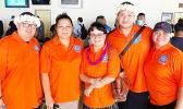 American Samoa Medicaid State Agency director, Sandra King-Young (middle) posed for a photo with her staff