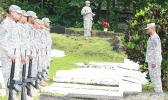soldiers saluting graves on Memorial Day in American Samoa