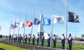 U.S.and American Samoa flags along with flags of the services at half staff