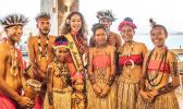Miss American Samoa with young entertainers in PNG