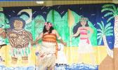 """American Samoa's very own """"Moana"""" — standing in front of classroom doors painted with the likeness of Disney's Maui and Moana"""