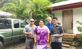 Mrs. Asoiva Togafau (center), with John and Ricky Leulu (far right)