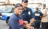 Defendant, Pati Lepou with a police officer