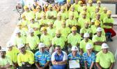 Taupau Tauileave Toluono with the construction staff