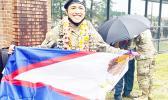 PFC Castro with American Samoa flag