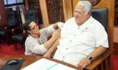 Samoa's Prime Minister Tuilaepa Sailele Malielegaoi receives his measles vaccination.