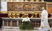 Pope Francis leaves at the end of Easter Sunday Mass