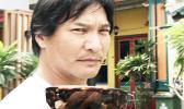 Movie actor, Jason Scott Lee displays the Popgear version of Popticals in Little India, Singapore. [photo: Barry Markowitz]