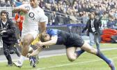 """This is a Sunday, March 11, 2012 file photo of England's Manu Tuilagi, left, as he runs to score a try despite the tackle of France's Aurelien Rougerie during their six nations rugby union match at the Stade de France stadium, in Saint Denis, outside Paris, Sunday. England's Rugby Football Union said Monday Aug. 7, 2017 that Manu Tuilagi and Denny Solomona have been sent home from a national team training camp. An RFU statement says the disciplinary action is a result of """"culture issues"""" with no further exp"""