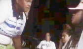 This photo is a screenshot from the video, showing head coach Annie Coffin - who is also a DPS police officer - addressing one of her players, only seconds before she allegedly put her hands on her.