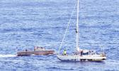 In this Wednesday, Oct. 25, 2017 photo, sailors from the USS Ashland approach a sailboat with two Honolulu women and their dogs aboard as they are rescued after being lost at sea for several months while trying to sail from Hawaii to Tahiti. The U.S. Navy rescued the women on Wednesday after a Taiwanese fishing vessel spotted them about 900 miles southeast of Japan on Tuesday and alerted the U.S. Coast Guard. The women, identified by the Navy as Jennifer Appel and Tasha Fuiaba, lost their engine in bad weat