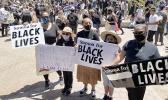 Leiataua Family members with Samoa for Black Lives Matter signs
